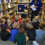 Reading owl stories with Miss Beth at the library