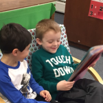 Friends enjoying a book